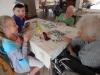Spotkanie Mieszkańców DPS z dziećmi ze Świetlicy przy grach planszowych